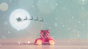 Toy Car with Christmas tree and gift box. Christmas landscape with gifts and snow. Merry christmas and happy new year greeting car Royalty Free Stock Photos