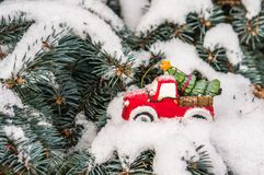 Toy car with Christmas tree on snowy branch fir Stock Photos