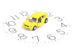 Toy car and clock face Stock Image