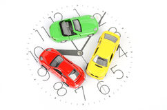 Toy car on clock face Royalty Free Stock Photo