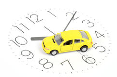 Toy car on clock face Stock Photos