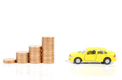 Toy car and coin Royalty Free Stock Image