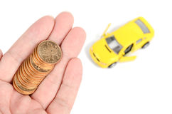 Toy car and coins Royalty Free Stock Image