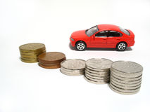 Toy car and coins Stock Photos