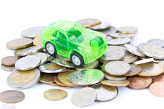 Toy car on coins Royalty Free Stock Images