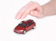Toy car covered with female hand Stock Photo