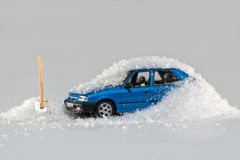 Toy car covered in snow Royalty Free Stock Images