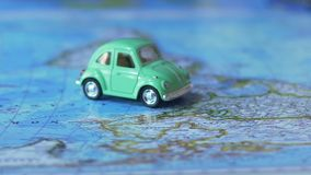 Toy car crossing world map poster, travel by auto around globe, vacation abroad. Stock footage stock video footage