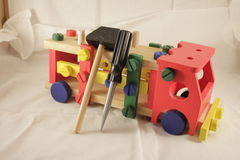 Toy car designer and tools. A hammer for children Stock Image
