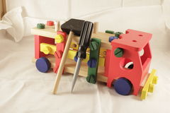 Toy car designer and tools. A hammer for children Stock Photos