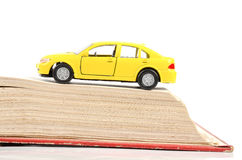 Toy car and dictionary Stock Images