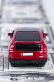 Toy Car on Dollar Banknotes as Road Royalty Free Stock Photography