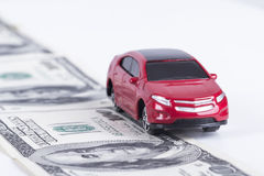 Toy Car on Dollar Banknotes as Road Royalty Free Stock Images