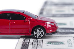 Toy Car on Dollar Banknotes as Road Stock Image