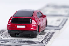 Toy Car on Dollar Banknotes as Road Stock Images