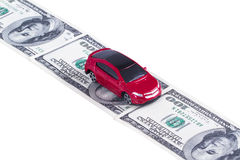 Toy Car on Dollar Banknotes as Road Stock Photos