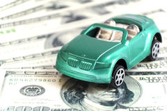 Toy car. On the dollars. The idea illustrates the purchase of a car Royalty Free Stock Image