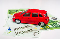 Toy car and euro money - insurance, rent and buying car. Toy car and euro money banknotes - insurance, rent and buying car concept stock photography