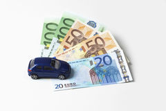 Toy car and fanned euro notes on white background Royalty Free Stock Photo