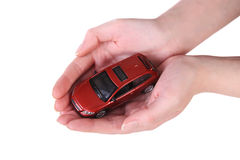 Toy car in female hands Royalty Free Stock Photo