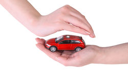 Toy car in female hands Stock Images