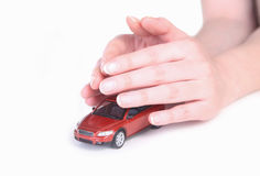 Toy car in female hands. Red toy car in female hands Stock Image