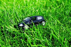 Toy car in grass Royalty Free Stock Photo