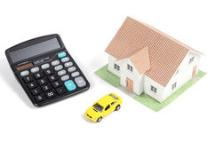 Toy car and house with calculator Royalty Free Stock Photography