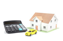 Toy car and house with calculator Stock Photos