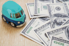 Toy car with hundred dollar bills Stock Photos