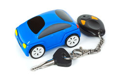 Toy car and keys. Isolated on white background Royalty Free Stock Images