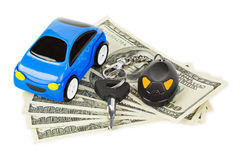 Toy car, keys and money Royalty Free Stock Photos
