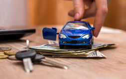 Toy car, keys and money Royalty Free Stock Image