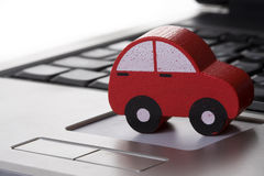 Toy car on a laptop Royalty Free Stock Image