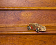 Toy Car left on stairs Royalty Free Stock Photo