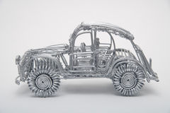 Toy car made of pliable wire against white background. Close up stock images