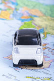 Toy Car on Map. Back view of white, small, toy car on map Stock Image