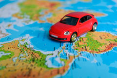 Toy car on the map Stock Images
