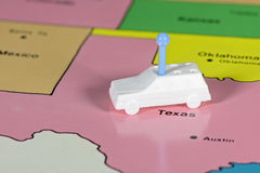 Toy car on a map of texas. White toy car on the state of Texas royalty free stock photography
