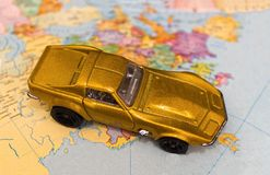 Toy car on a map. Travel, tourism concept. Selective focus Royalty Free Stock Photography