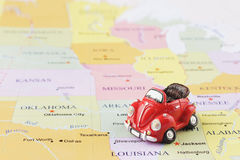 Toy car on map. Toy car on the Usa map Stock Image