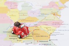 Toy car on map. Toy car on the Usa map Royalty Free Stock Photos