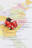 Toy car on map Royalty Free Stock Photos