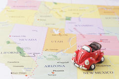 Toy car on map. Toy car on the USA map Royalty Free Stock Image