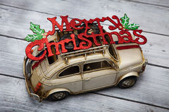 Toy car with Merry Christmas sign Royalty Free Stock Photos