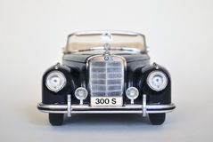 Toy car model Mercedes-Benz 300S 1955. Toy Mercedes-Benz 300S 1955  car model on a white background Royalty Free Stock Image