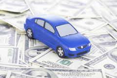 Toy car on money Royalty Free Stock Image