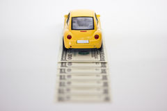 Toy car and money Royalty Free Stock Images