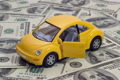 Toy car and money Royalty Free Stock Image