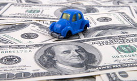 Toy car on money background. Toy retro car on money background, business concept Stock Photography